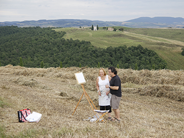 Prof. Yves M. Larocque with a student painting in Tuscany during Walk the Arts art courses in Italy