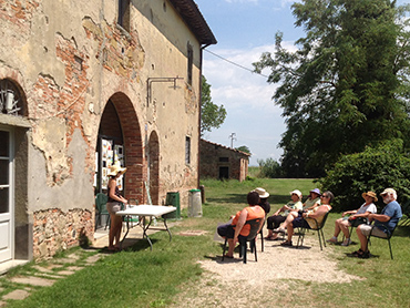 Artists discussing about their paintings during our plein air painting workshop in Tuscany