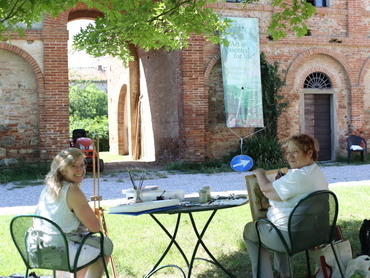 two painters enjoying our art workshop in Italy offered since 1997
