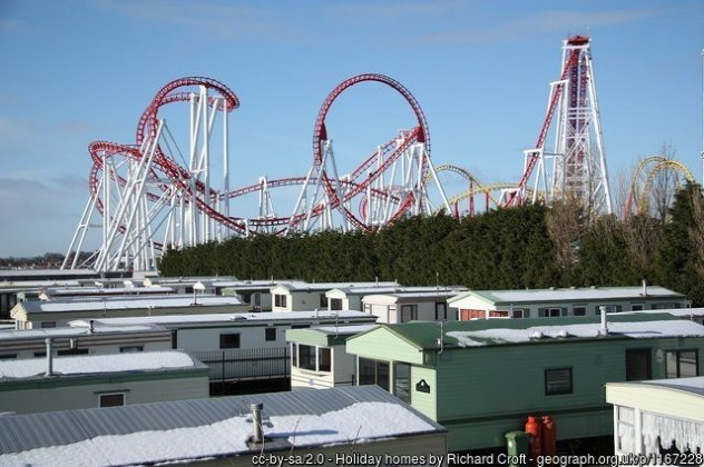 Holiday homes Static caravans at Ingoldmells with the Fantasy Island roller coaster looming behind