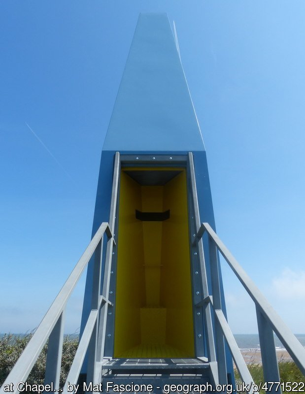 The Sound Tower at Chapel Six Marshes Part of the Structures on the Edge Project, the tower was erected in Spring 2014. Viewers approach the tower to find an internal yellow vessel with no view. As users enter, the whole interior chamber lowers to engage a controlled view of the horizon. This is accompanied by a resonant sound created by a striking 'gong' that announces the towers use to people on the beach. Furthermore the lowering chamber engages a wind channel that allows the whole tower to act as a wind funnel that amplifies the natural conditions of the site.