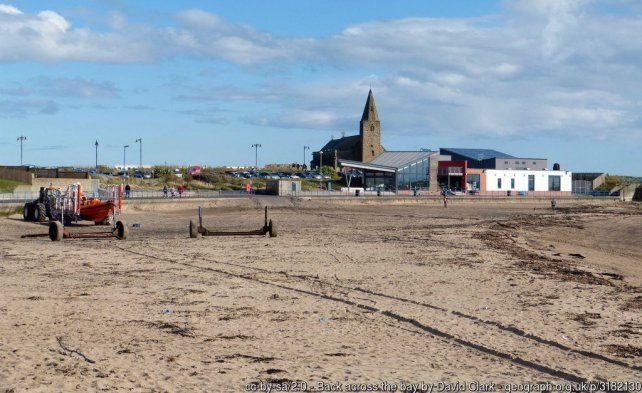 Back across the bay At Newbiggin-By-The-Sea, St Bartholomew's and The Maritime centre in the view