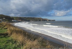 Dark clouds gathering over Sandsend A day of sunshine and showers, pictured with an incoming tide