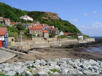 Runswick Bay Sheltered from the north winds by Lingrow Knowle, the quaint village of Runswick Bay with its white painted cottages and neat gardens looks out on one of the loveliest bays in the north of England.