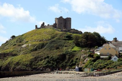 Cricieth Castle is a native Welsh castle situated on a rocky peninsula overlooking Tremadog Bay.