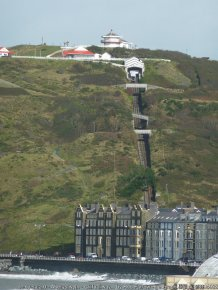 Aberystwyth - Cliff railway climbs Constitution Hill Constitution Hill rises from sea level to 114m (374') to the north of Aberystwyth. Climbing most of this is the Cliff Railway (see shared description below). The guest houses and hotels on the New Promenade cluster along the sea front below it.