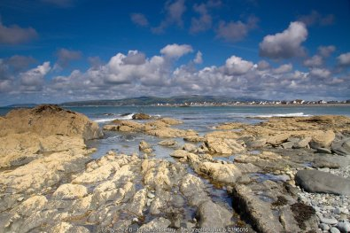 Borth on a really good day And there are many of them in Borth, despite many drab, wet days too. Down among the rock pools looking across to the main part of the village