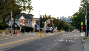 View looking north. Unfortunately, recent Comcast utility work has damaged crosswalk and bike lane markings.