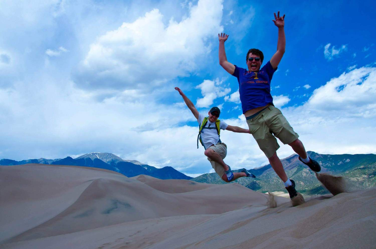 Adam and Andrew in an Action Shot at Great Sand Dunes National Park and Preserve in Colorado.