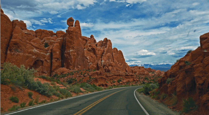 picture of road and rocks for budget friendly vacation