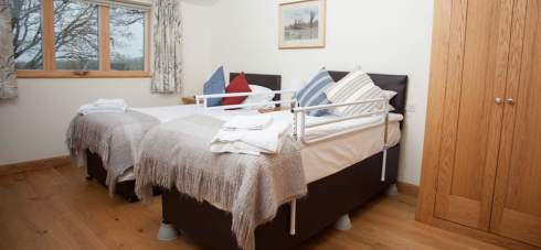 Bed risers for accessible guests at Wallops Wood Cottages