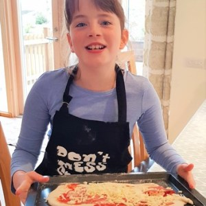 Sophie and her pizza making experience at Wallops Wood Cottages