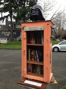 Gina sent us this snap of an awesome Little Free Library lorded by Darth Vader on N. 57th St. (in Tangletown)