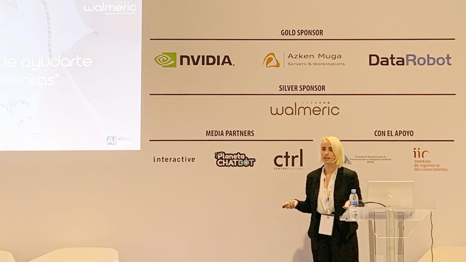 Irene Medina, Marketing Director at Walmeric, giving a talk in AIshow