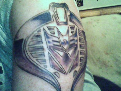 Superman and went ahead and modified the Transformers tattoo with Cobra