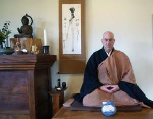 Hozan Alan Senauke waits to demo oryoki in the Berkeley Zen Center zendo.