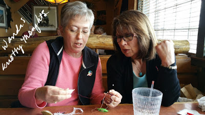Becky helping Sherry with a knotty problem