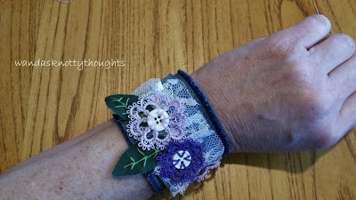 Denim cuff with tatted flowers in purple on wandasknottythoughts