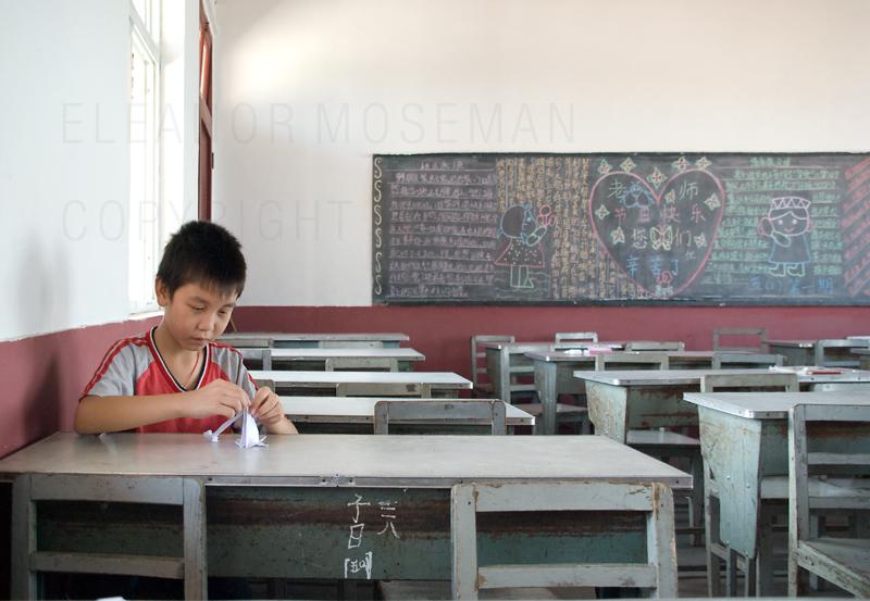 Little Boy Folding Paper