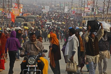 People flooding the Sangam during Magh Mela