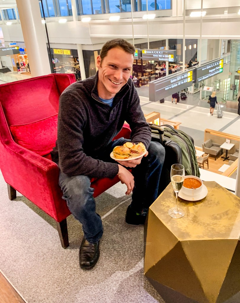 Enjoying champagne and dinner at a British Airways lounge. Our tips can guide you to have this experience.