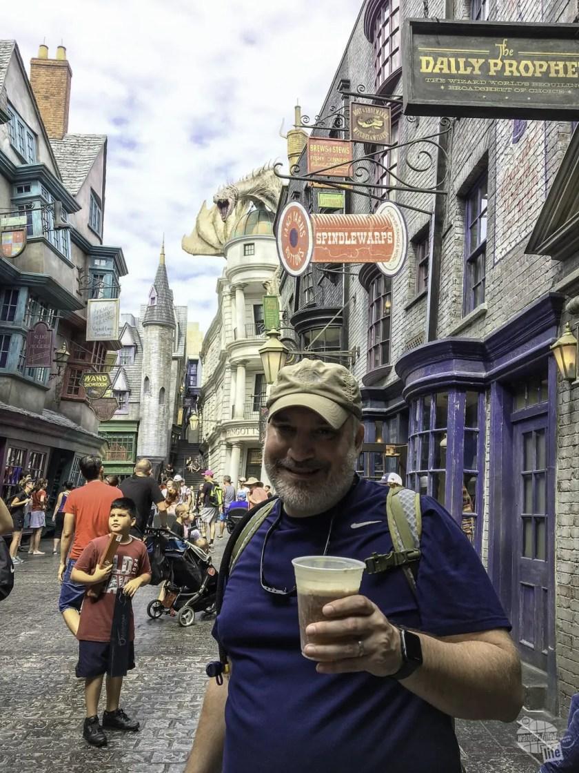 Grant trying a butterbeer in Diagon Alley.