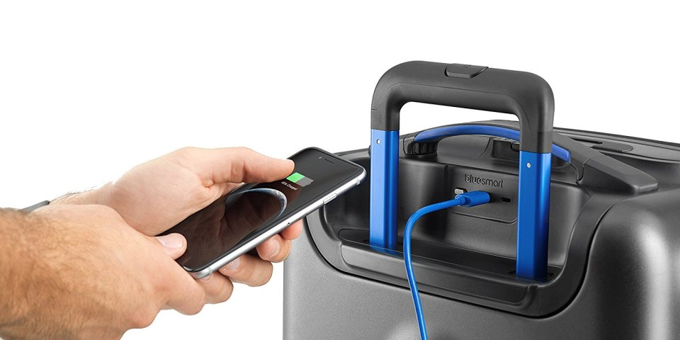 Bluesmart One smart luggage in use to charge phone