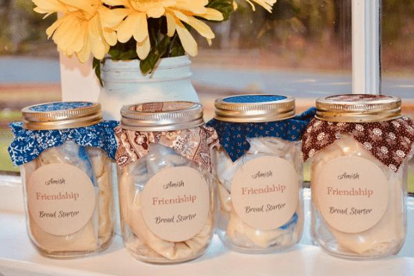 amish friendship bread starter jars sitting on window sill