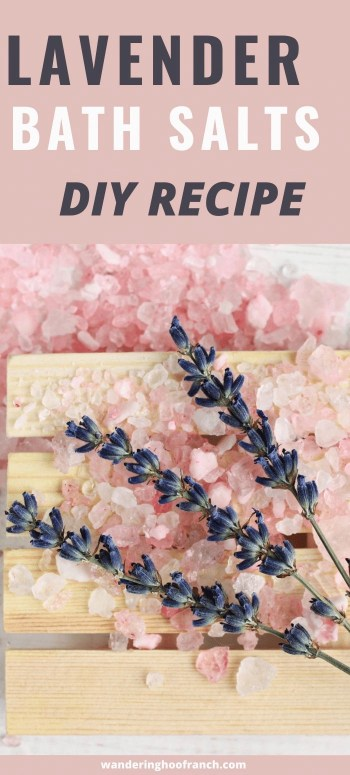 lavender bath salts diy recipe for Pinterest image. lavender sprig on wood crate with pink sea salt