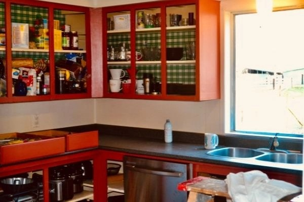 creating a simple kitchen by simplifying baking supplies, open cupboards getting painted and tied up
