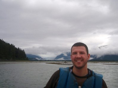 Man kayaking with a view of the Mendenhall Glacier in the background while on an Alaska cruise excursion.