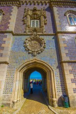 colourful tiles and intricate stonework line the entranceway to Pena Palace - Sintra, Portugal