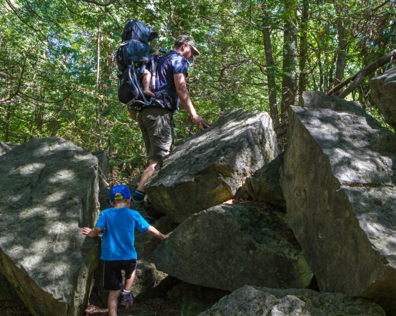 Kevin-and-the-boys-climb-large-rocks-near-the-lime-kiln-at-Limehouse-Conservation-Area-in-Ontario