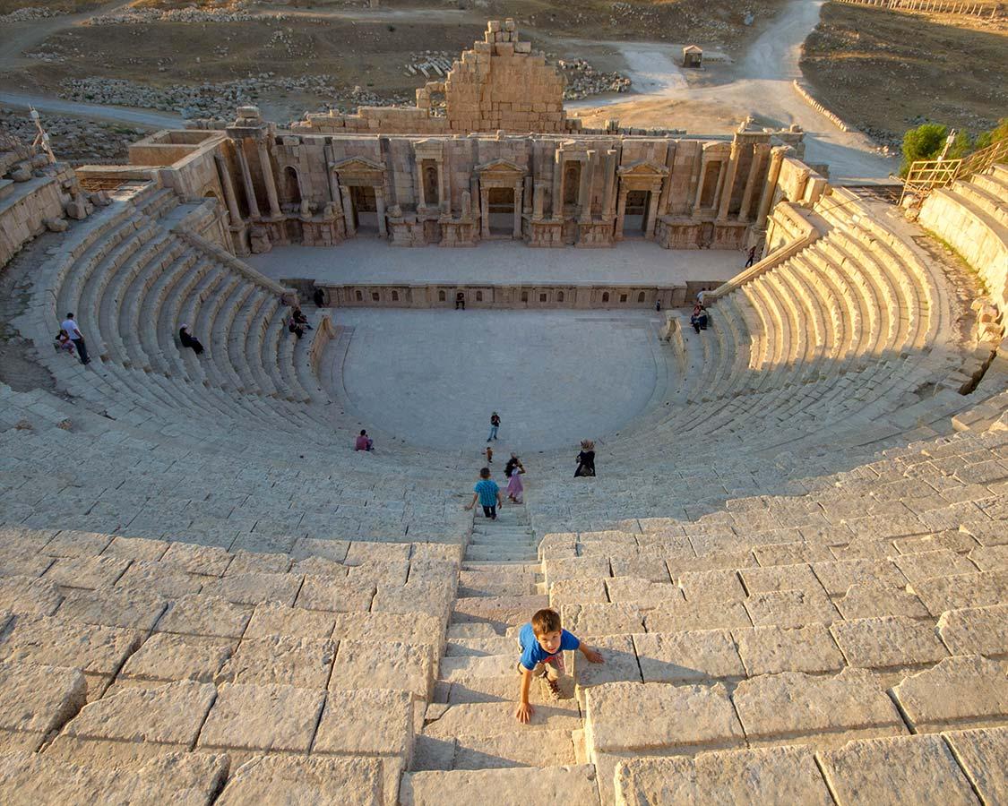 Boy climbs the Jerash amphitheater