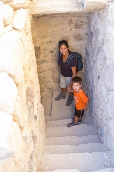 Woman and young boy exploring underground stairs