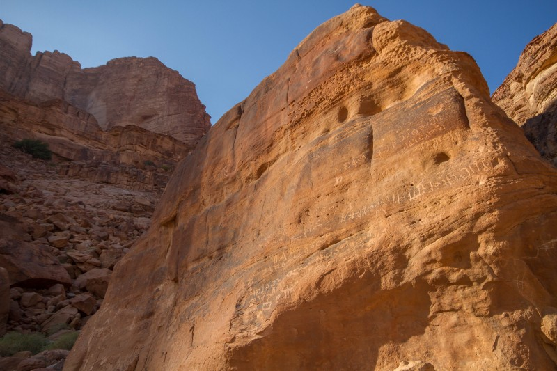 A rock in Wadi Rum Jordan with ancient Nabatean inscriptions on it.