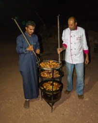 Bedouin cooks bring out food in Wadi Rum
