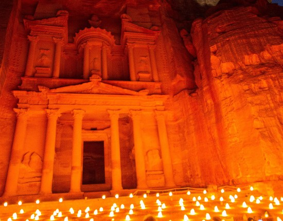 The treasury building in Petra is lit up at night by thousands of candles - Traveling Jordan with Kids