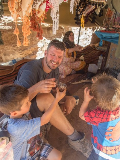 Father and two boys drinking tea with a Bedouin in Jordan