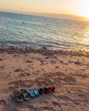 Red Sea Beach with 2015 Jordan written in the sand.
