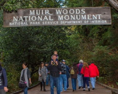 Father with son at main trail entrance of Muir Woods National Monument