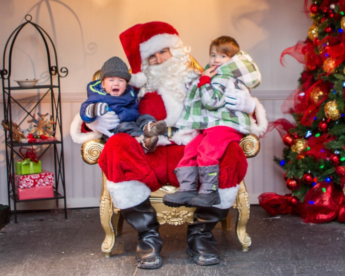 Toronto Christmas Market Santa with one happy and one not-so-happy boy on his lap