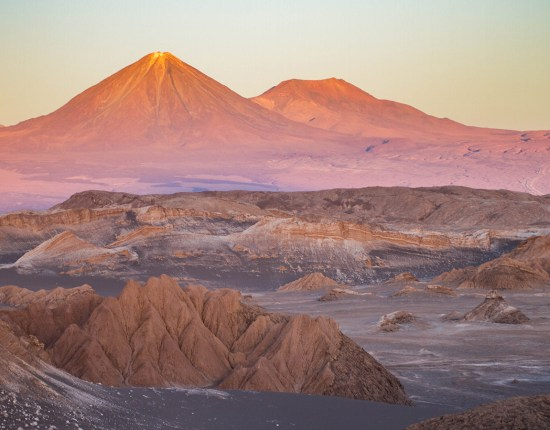 The Andes mountain act as a backdrop to the alien landscape of the Valle de la Luna in Chile