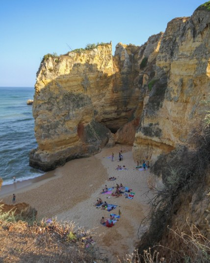 People on a beach in Lagos Portugal