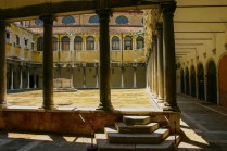 an empty open-air courtyard lined with columns in Venice, Italy - Lost in Venice