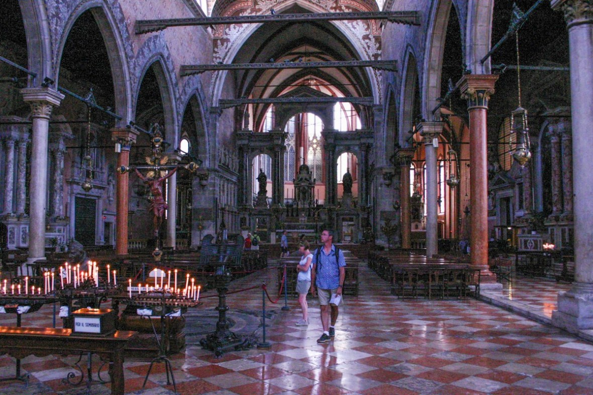 Tourists look through St. Marks Cathedral in Venice, Italy - Lost in Venice
