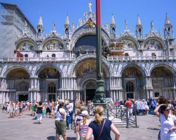 Tourists look at St. Marks Cathedral in Venice, Italy - Lost in Venice