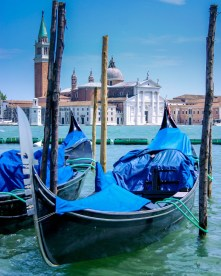 Blue covered Gondola's lining the rivers of Venice - Lost in Venice