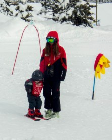 Little boy getting a lesson from a ski instructor - Learning to Ski at Kelowna's Big White