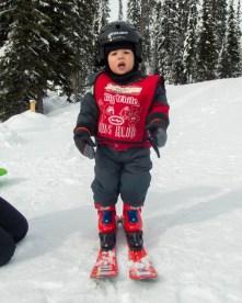 Little boy wearing ski outfit - Learning to Ski at Kelowna's Big White